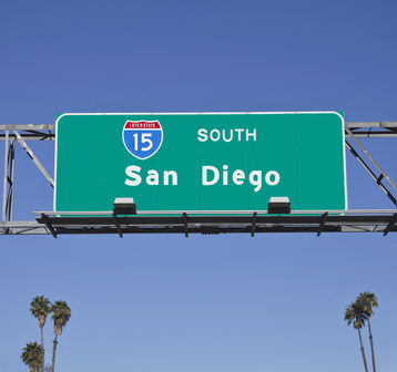 San Diego 15 Freeway sign with palm trees.